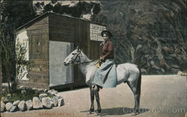 Woman seated on horse in front of shack Cowboy Western