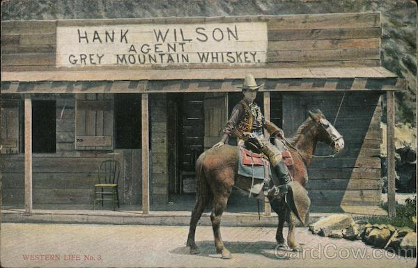 Cowboy on horse outside of Hank Wilson Grey Mountain Whiskey shop