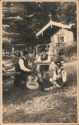 Trio of musicians seated outside
