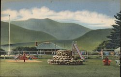 Playground and Golf Course with Moat and Mountain in Background