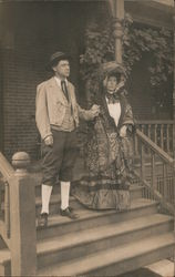 Man and Woman Holding Hands on the Stairs Postcard
