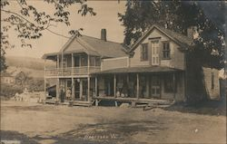 Two Children Standing in Front of General Store