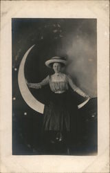 Woman Posing on Crescent Paper Moon Postcard