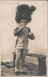 A Little Boy in a Uniform and a Large Hat Eating French Bread Postcard