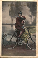 A Man Holding a Bouquet of Flowers while Riding a Bike