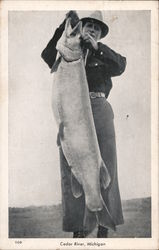 Man Holding Large Fish