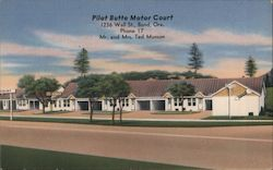Pilot Butte Motor Court - 1236 Wall Street - Mr and Mrs Ted Munson Postcard
