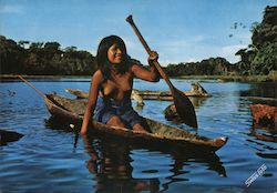 Peru. Amazon Jungle. Nude Jibaro Girl in a Canoe Postcard