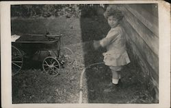 Child Playing Outside with Wagon