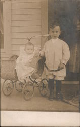 Two Children on Porch, Baby Carriage