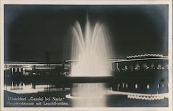 """GeSoLei at Night"", restaurant with light fountain"