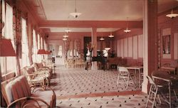 View of One of Four Spacious Lounges in the North End Hotel Postcard