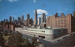 Mid-Manhattan Skyline showing the new East Side Airlines Terminal in Foreground Postcard