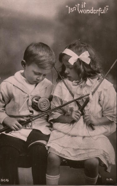 Isn't it Wonderful? -- A little boy & girl have their fishing rods & lines tangled