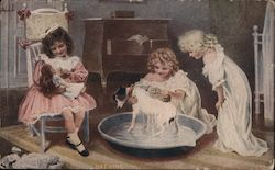 Three Little Girls, One Washes a Dog