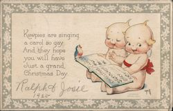 Kewpie Dolls at Christmas Postcard