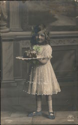 Girl Holding Plate With Cake