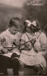 """Isn't it Wonderful?"" -- A little boy & girl have their fishing rods & lines tangled"