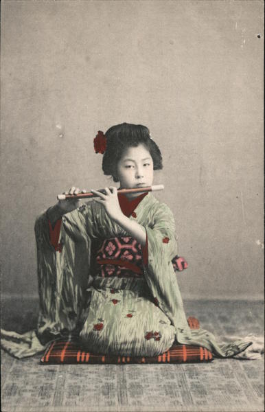 A Geisha lady with a flute Japan