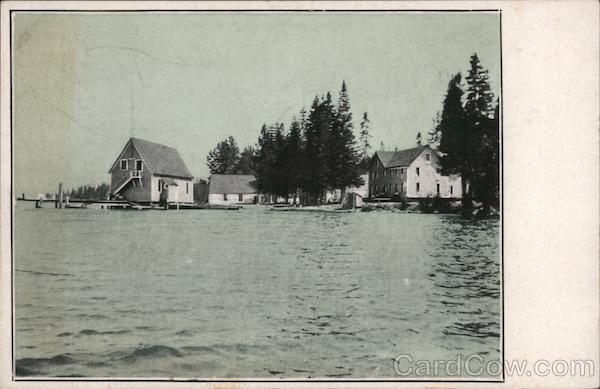 View of boat house, houses on water New Hampshire