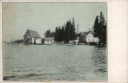 View of boat house, houses on water