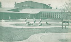 Sunny days bring dozens of youngsters to these wading pools provided for war workers' children.