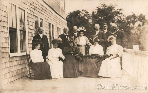A Group of Men and Women Posing on a Balcony Family Portaits