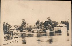 Unidentified Lake Shore Scene With Boathouses