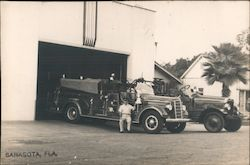 A Man Sitting on the Side of a Fire Truck