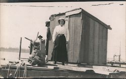 Woman and Two Men on Dock