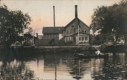 Man Canoeing on River, Factory Buildings