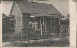 Snapshot of Family on Porch of House