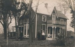 Family Posing in Front of Missouri Home
