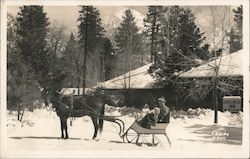 Man and Baby in Horse Drawn Sleigh, Idyllwild Inn