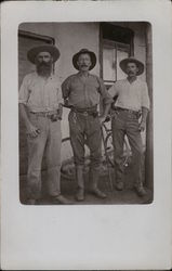 Three Men with Cowboy Hats on a Porch Postcard