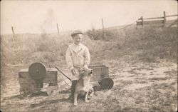 Boy with His Dog in Field with Wagon, Toys