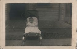 Baby in Stroller in front of house