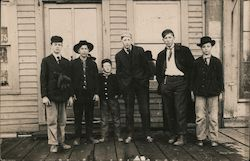 Group of Young Men and Boys Standing on a Porch