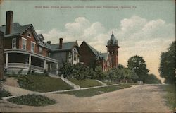West Main Street showing Lutheran Church and Parsonage Postcard