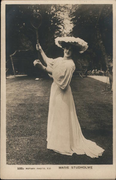 A Woman Holding a Tennis Racket Up