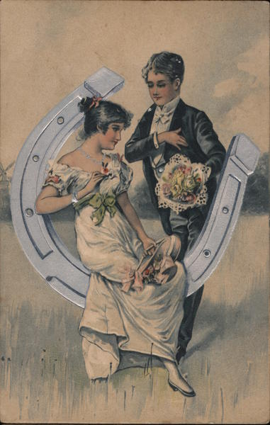 A Man and a Woman With a Horse Shoe and Flowers Couples