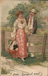 A Man and Woman Standing by a Wooden Fence