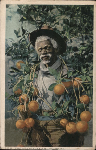 Black man holding oranges Fruit