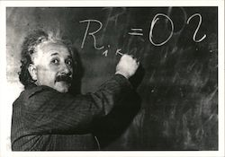 Albert Einstein Writing on Chalkboard