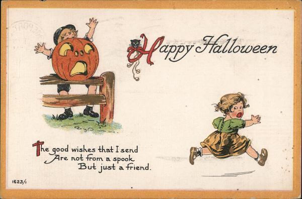 Happy Halloween - boy behind carved pumpkin scares little girl, who runs away
