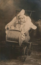 Classic Photo of Baby in Turn-of-the-Century Wicker Stroller