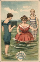 Look Pleasant Please, A Man and Woman Have Their Picture Taken By Second Man in the Water