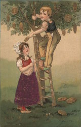 Boy and girl picking money off tree