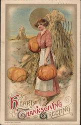 HEARTY THANKSGIVING GREETING - WOMAN IN PUMPKIN PATCH, HOLDING PUMPKINS Postcard