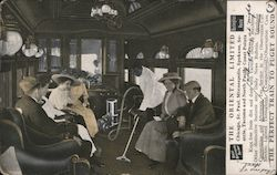 The Original Limited - People sitting on a train as it is being vacuumed.